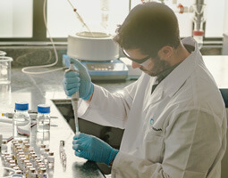 a cannasouth scientist working in the lab